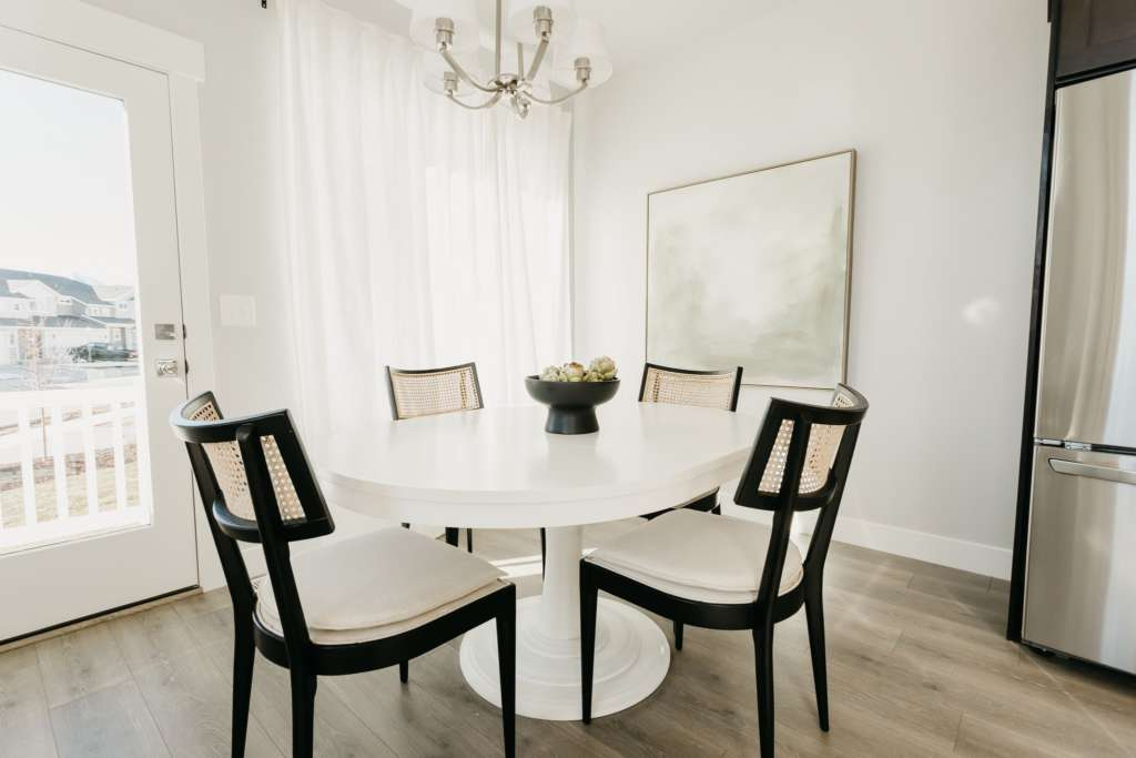 white dining room table with black dining chairs